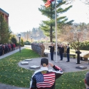 veteran's day ceremony by the flagpole on campus