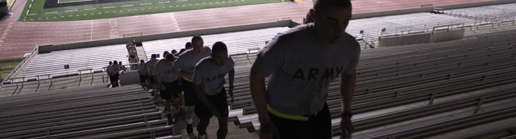 cadets marching up stairways in the football stadium