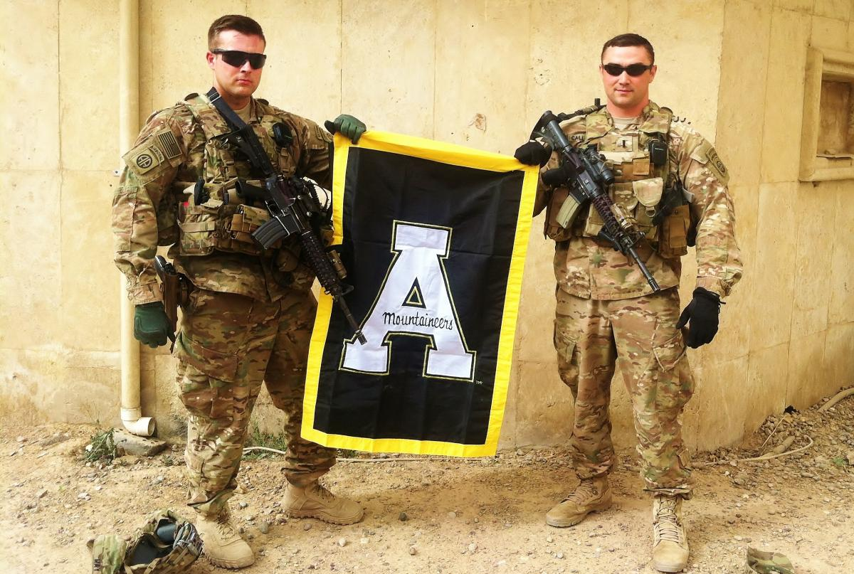 soldiers holding App State Banner during deployment in Iraq