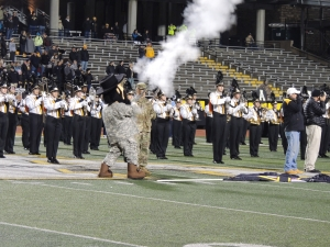 ROTC Yosef Fires the Musket Announcing the Team